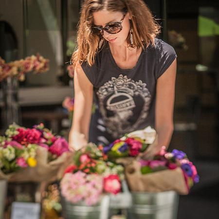 Flower seller near the Grand Lake Saturday Market, Oakland, CA (© Clark James Mishler)