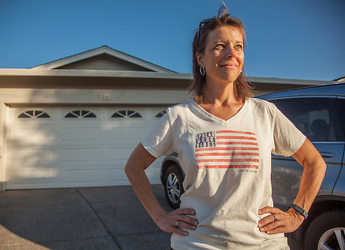 "Education specialist Stacy Freeman in front of her home in Martinez, CA.  ""I am sure my wearing this shirt will make a difference for the American athelets in Rio!"" (Clark James Mishler)"