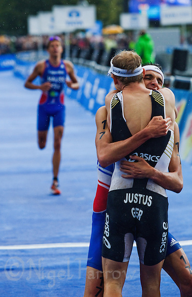 07 AUG 2011 - LONDON, GBR - Laurent Vidal (FRA) (right) celebrates with Steffen Justus (GER) after finishing the men's round of triathlon's ITU World Championship Series (PHOTO (C) NIGEL FARROW) (NIGEL FARROW/(C) 2011 NIGEL FARROW)