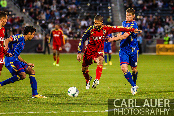 April 6th, 2013 - Real Salt Lake midfielder Enzo Martinez (19) attempts to get a shot off between the defense from Colorado Rapids midfielder Tony Cascio (14) and midfielder Dillon Powers (8) during the second half of the MLS match between Real Salt Lake and the Colorado Rapids at Dick's Sporting Goods Park in Commerce City, CO (Carl Auer/Newsport)