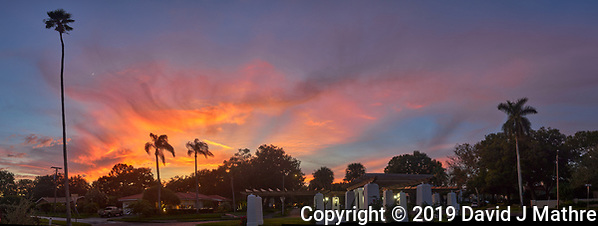 Colorful clouds after sunset. Andalusia Plaza in Granada Terrace. Historic Northeast St. Petersburg, Florida. Composite of 9 images taken with a Leica CL camera and 23 mm f/2 lens (ISO 100, 23 mm, f/2.8, 1/60 sec). Raw images processed with Capture One Pro and AutoPano Giga Pro. (DAVID J MATHRE)