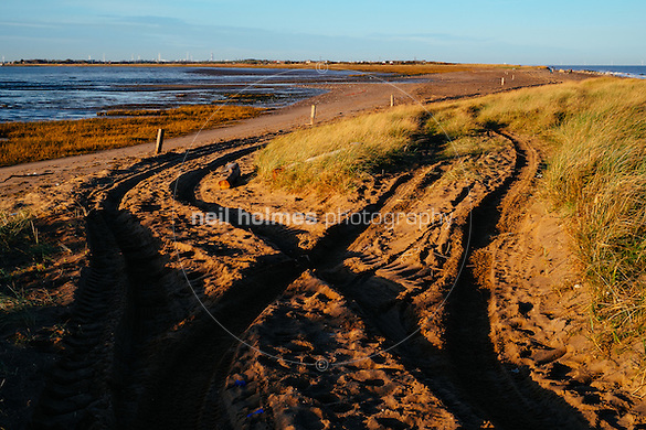 Spurn Head, Spurn, East Yorkshire, United Kingdom, 06 December, 2014. Pictured: Tyre marks in the sand were the head is breached by regular high tides (Neil Holmes)