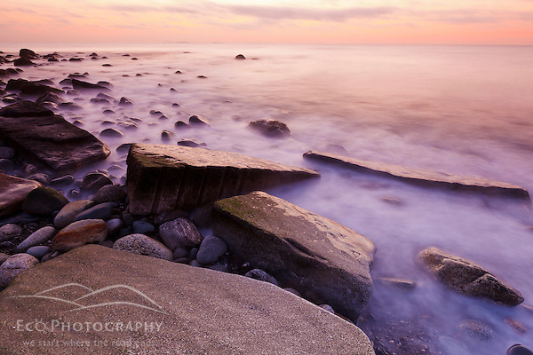 Pre-dawn light and waves wash over the rocks at Rye Harbor State Park in Rye, New Hampshire. (Jerry Monkman)
