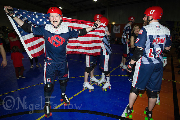 16 MAR 2014 - BIRMINGHAM, GBR - Jammer Jonathan R celebrates Team USA winning the inaugural Men's Roller Derby World Cup final against Team England in the Futsal Arena in Birmingham, West Midlands, Great Britain (PHOTO COPYRIGHT © 2014 NIGEL FARROW, ALL RIGHTS RESERVED) (NIGEL FARROW/COPYRIGHT © 2014 NIGEL FARROW : www.nigelfarrow.com)