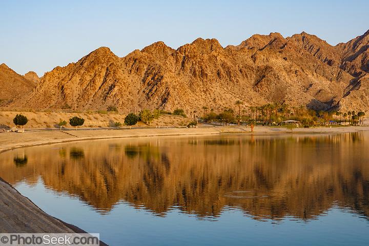 San Jacinto Mountains reflect in Lake Cahuilla Veterans Regional Park Campground, La Quinta, California, USA. (© Tom Dempsey / PhotoSeek.com)