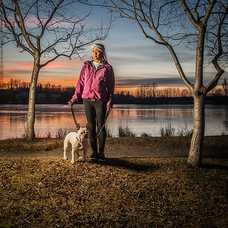 UAA accounting student Annie Nguyen and her French Bull Dog, Milo, at Westchester Lagoon, Anchorage (Clark James Mishler)