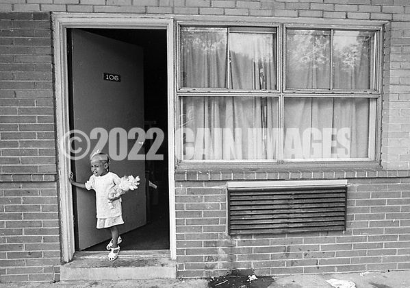 4 year old Dionna Thomas looks out the door at the George Washington Motor Lodge, where she and her mother are living Tuesday June 23, 1992 in Bensalem, Pennsylvania. (WILLIAM THOMAS CAIN / For The Philadelphia Inquirer) (William Thomas Cain/Cain Images)