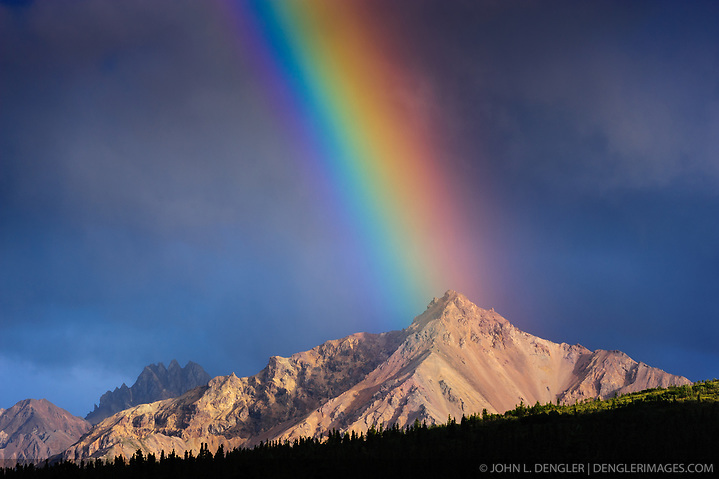 An evening rainbow basks upon an unnamed mountain of the Alaska Range located in the upper Teklanika River valley in Denali National Park and Preserve. The view is from the Igloo Creek Campground. (John L. Dengler)