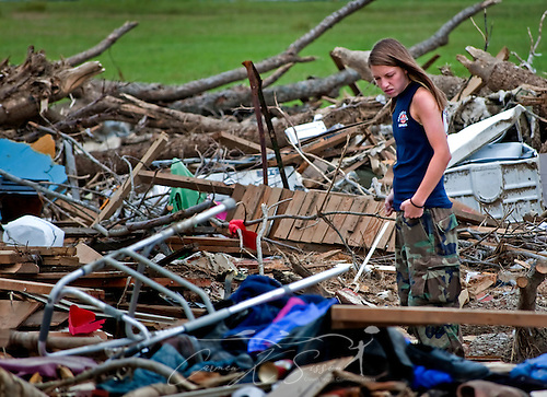 Taylor Ann Boozer walks through the rubble of a demolished home May 15, 2011 in Smithville, Mississippi. Jesse Cox, 85, died in the house, and his wife, Nell Cox, 75, was seriously injured when an EF5 tornado swept through the town on April 27, 2011. (Photo by Carmen K. Sisson/Cloudybright) (Carmen K. Sisson/Cloudybright)