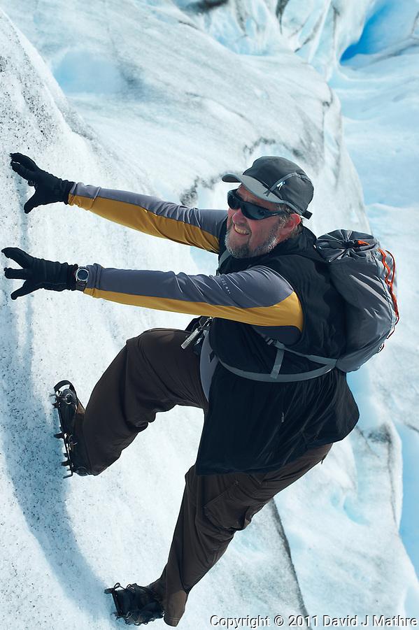 Thom Hogan climbing Perito Moreno Glacier without any ropes. Image taken with a Nikon D3s camera and 50 mm f/1.4 lens (ISO 200, 50 mm, f/7, 1/200 sec). (David J Mathre)