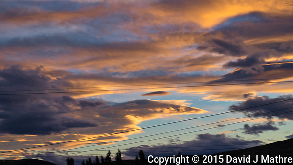 Clouds at Dusk on the way to the El Calafate in Argentina. Image taken from a moving bus with a Fuji X-T1 camera and 55-200 lens (ISO 400, 55 mm, f/10, 1/125 sec). (David J Mathre)