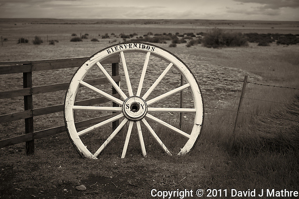 Bienvenidos (Welcome) Wagon Wheel Along a Wood and Barbed Wire Fence at an Estancia in Patagonia. Image taken with a Nikon D3s and 50 mm f/1.4G lens (ISO 200, 50 mm, f/4, 1/2000 sec). (David J Mathre)