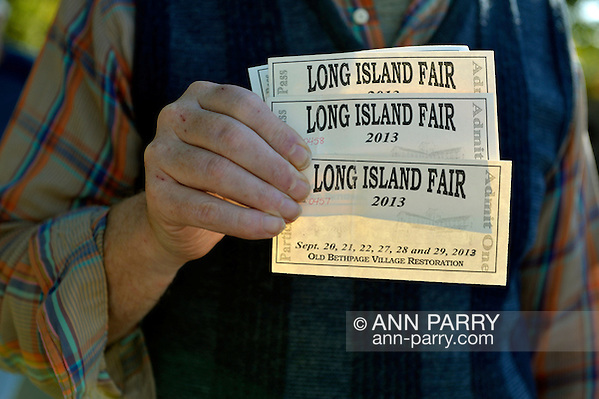 Old Bethpage, New York, U.S. 29th September 2013. Bob Stuhmer holds four admission tickets at The Long Island Fair. A yearly event since 1842, the county fair is now held at a reconstructed fairground at Old Bethpage Village Restoration. (Ann Parry/Ann Parry, ann-parry.com)