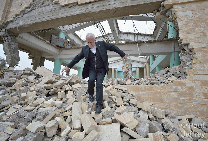 Father Emanuel Youkhana walks through the rubble of a church in Mosul, Iraq, on January 27, 2017. The church belonged to the Ancient Church of the East. According to neighbors, the Islamic State group--which took over the city in 2014--used the building as a warehouse until the final weeks of their occupation, when they awarded the building to a contractor who began to demolish it in order to salvage the steel rebar in the walls. Although this portion of the city was liberated in early 2017, Christians are unlikely to return soon due to concerns about their security in the Sunni community. Youkhana is a priest in Duhok of the Holy Apostolic Catholic Assyrian Church of the East. (Paul Jeffrey)