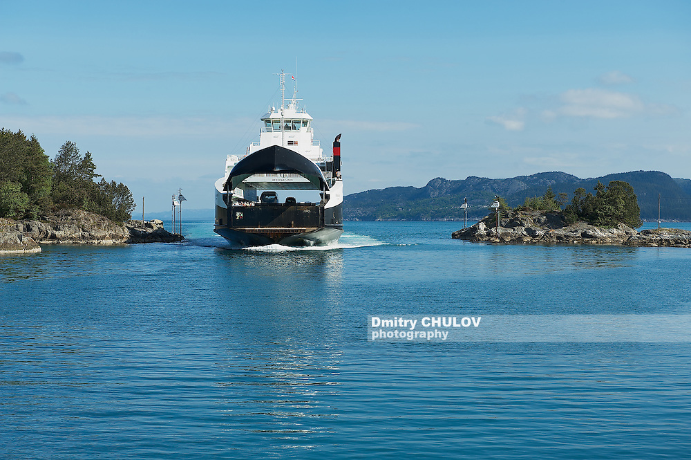 TVEIT, NORWAY - JUNE 06, 2010: Ferry boatz arrives to the port in Tveit, Norway. (Dmitry Chulov)