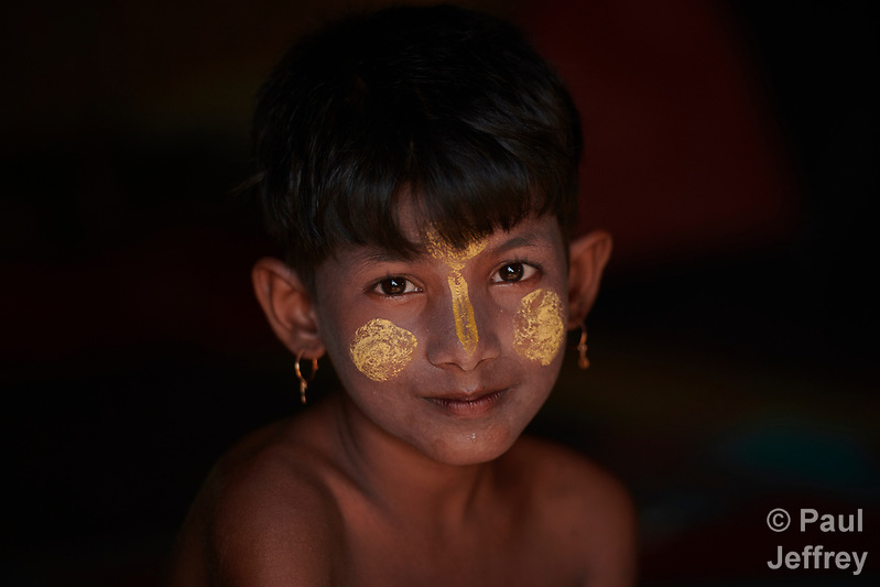 A Rohingya girl in the Jamtoli Refugee Camp near Cox's Bazar, Bangladesh. Her face is marked with thanakha, a traditional Burmese cosmetic. More than 600,000 Rohingya have fled government-sanctioned violence in Myanmar for safety in Bangladesh. (Paul Jeffrey)