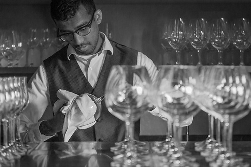 Bussman Akram Buhary polishes wine glasses at the Farmhouse Inn in Sonoma County (Clark James Mishler)