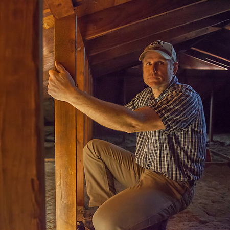 Contractor Rex Heywood inspects the attic of the School Street home in Calistoga prior to the remodel of the kitchen (Clark James Mishler)
