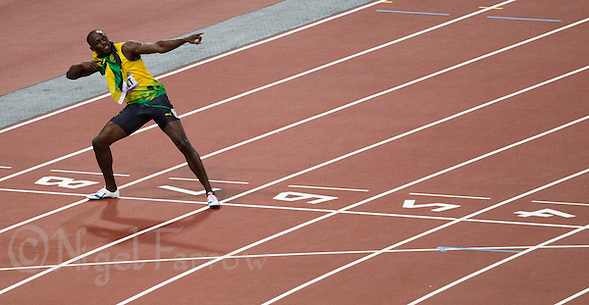 09 AUG 2012 - LONDON, GBR - Usain Bolt (JAM) of Jamaica celebrates winning the men's 200m final during the London 2012 Olympic Games athletics at the Olympic Stadium in Stratford, London, Great Britain (PHOTO (C) 2012 NIGEL FARROW) (NIGEL FARROW/(C) 2012 NIGEL FARROW)