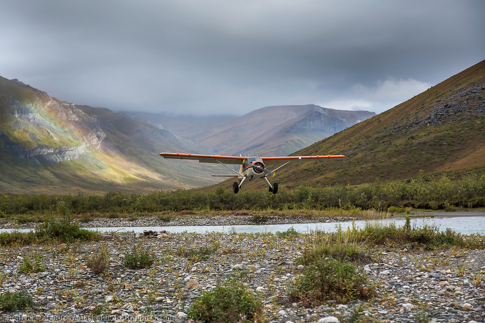 Bush plane approaches landing, Noatak River, Gates of the Arctic National Park, Alaska (Patrick J Endres / AlaskaPhotoGraphics.com)