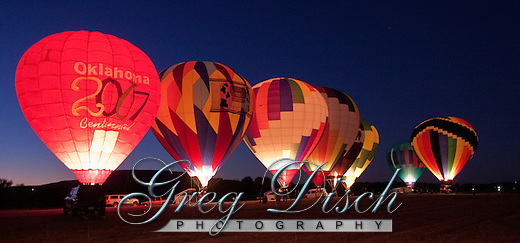 "Poteau Oklahoma Balloon Fest 2009. Taken during what is called a ""balloon glow"".  A hot air balloon glow is when the balloons are set up and inflated at night or dusk, and the pilots light the inside of the balloon with the propane burner used to create the hot air that causes the balloons to fly.  The flames from the burner cause the colorful balloon envelopes to glow in the dark.  The balloons due not actually take off, so the pilots can only run the burner for a short time and then let it cool down to keep from lifting off. (Greg Disch)"