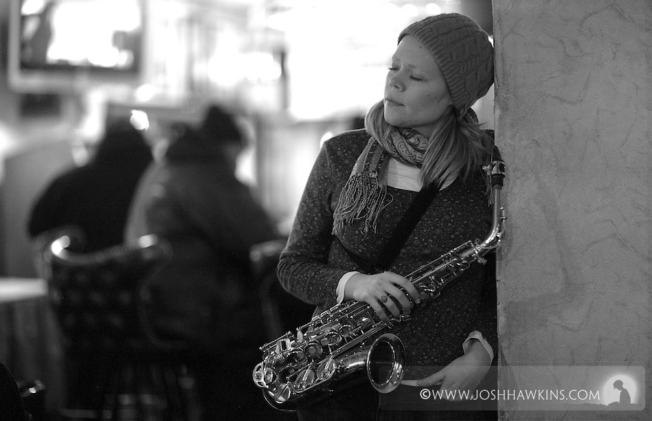 Caroline Davis listens to jazz at the New Apartment Lounge before going on to perform herself. (Josh Hawkins)