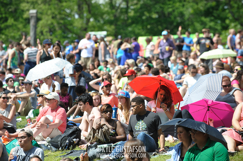 COLUMBIA, MD - May 11th, 2013 - Concert goers use umbrellas to shield themselves from the sun at the 2013 Sweetlife Food and Music Festival at Merriweather Post Pavilion in Columbia, MD. (Photo by Kyle Gustafson / For The Washington Post) (Kyle Gustafson/Photo by Kyle Gustafson)