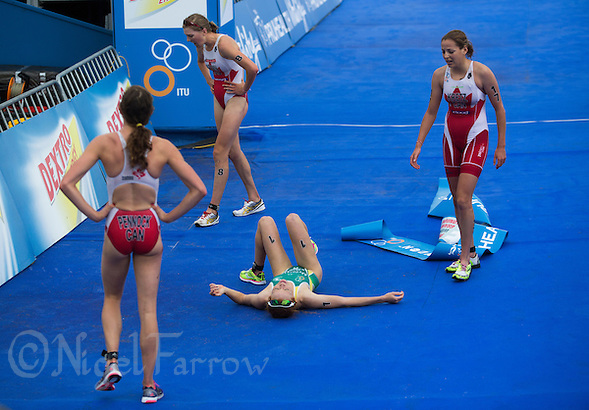 12 SEP 2013 - LONDON, GBR - Charlotte McShane (AUS) (centre, lying down) of Australia recovers after winning the under 23 women's ITU 2013 World Championships in Hyde Park in London, Great Britain (PHOTO COPYRIGHT © 2013 NIGEL FARROW, ALL RIGHTS RESERVED) (NIGEL FARROW/COPYRIGHT © 2013 NIGEL FARROW : www.nigelfarrow.com)