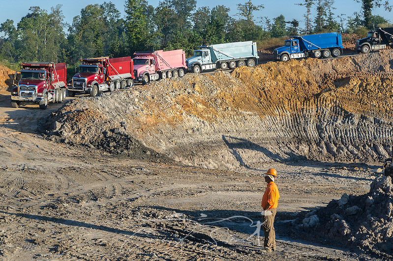Keith Radford, owner of KR Trucking, watches as his fleet of Mack Granite dump trucks head into a clay pit, Sept. 20, 2016, in Huntingdon, Tenn. The company, which mines both kaolin and ball clay, uses primarily Mack Granites in its fleet. (Photo by Carmen K. Sisson/Cloudybright) (Carmen K. Sisson/Cloudybright)