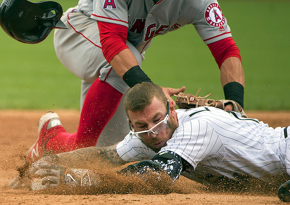 CHICAGO - APRIL 21: Brett Lawrie #15 of the Chicago White Sox slides safely into second base with a double in the second inning against the Los Angeles Angels of Anaheim on April 21, 2016 at U.S. Cellular Field in Chicago, Illinois. The Angels defeated the White Sox 3-2. (Photo by Ron Vesely) Subject: Brett Lawrie (Ron Vesely)