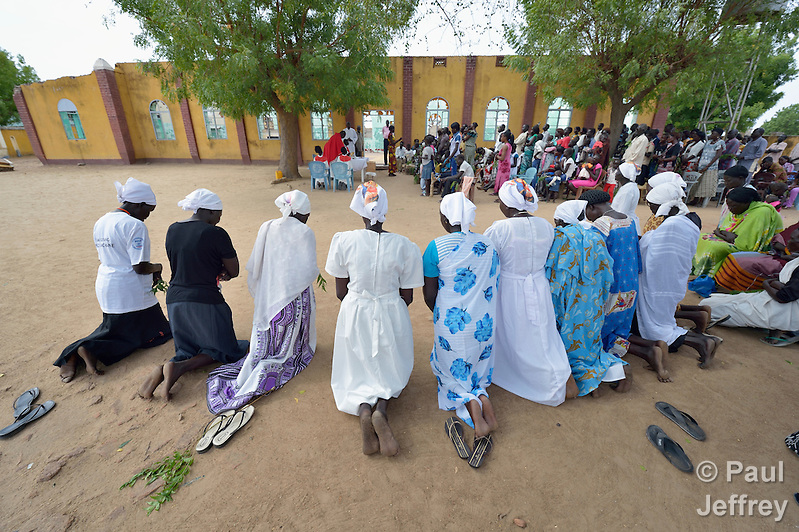 Women kneel during a Palm Sunday Mass at the Catholic Church in Abyei, a contested region along the border between Sudan and South Sudan. Under a 2005 peace agreement, the region was supposed to have a referendum to decide which country it would join, but the two countries have yet to agree on who can vote. In 2011, militias aligned with Khartoum looted and destroyed much of the church and drove out most of the Dinka Ngok residents, pushing them across a river into the town of Agok. Yet more than 40,000 Dinka Ngok have since returned, with support from Caritas South Sudan, which has drilled well, built houses, opened clinics and provided seeds and tools for the returnees. Yet violence has continued, with a March 1 militia attack killing four residents, according to the United Nations. (Paul Jeffrey)