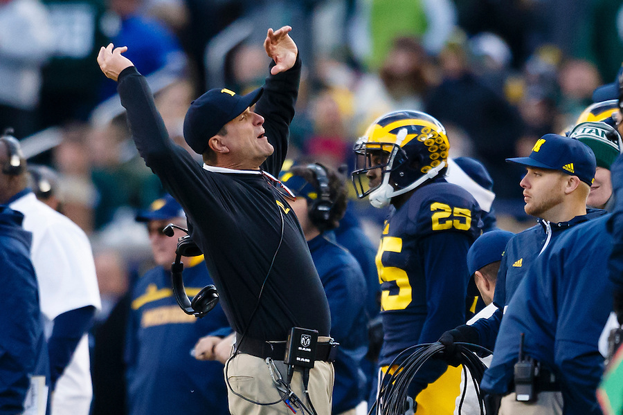 Oct 17, 2015; Ann Arbor, MI, USA; Michigan Wolverines head coach Jim Harbaugh reactes to a call in the fourth quarter against the Michigan State Spartans at Michigan Stadium. Mandatory Credit: Rick Osentoski-USA TODAY Sports (Rick Osentoski/Rick Osentoski-USA TODAY Sports)