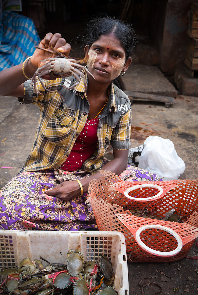 YANGON, MYANMAR - CIRCA DECEMBER 2013: Woman selling crab in the Yangon street market. (Daniel Korzeniewski)