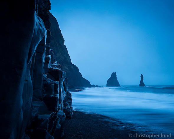 Reynisfjara black sand beach on the south coast of Iceland. Reynisdrangar sea stacs in background. January morning twilight. (Christopher Lund/©2013 Christopher Lund)
