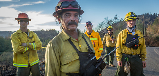 Crew Chief Jonathon Alvarez works with his Roseburg, Oregon Diamond Fire Crew members as they remove brush on Franz Valley School Road after the Tubbs Fire in Sonoma County. (Clark James Mishler)