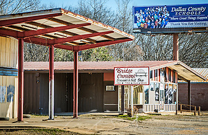 An abandoned storefront, Bridge Crossing Souvenir & Gift Shop, sits beside Civil Rights Memorial Park, Feb. 7, 2015, in Selma, Alabama. The park was established in 2001 and includes murals and plaques honoring those who led the Civil Rights movement in Selma in the 1960's. (Photo by Carmen K. Sisson/Cloudybright) (Carmen K. Sisson/Cloudybright)