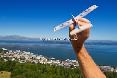 A man throws an airplane from the observation deck of the Astoria Column that overlooks the town of Astoria, Oregon in August of 2013. (Beth Hall)