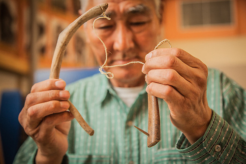 Grant Ballot, of Selawik, with a traditional fish hook at the Elder's Conference, Kotzebue, The Purchase Centennial Poject (Clark James Mishler)
