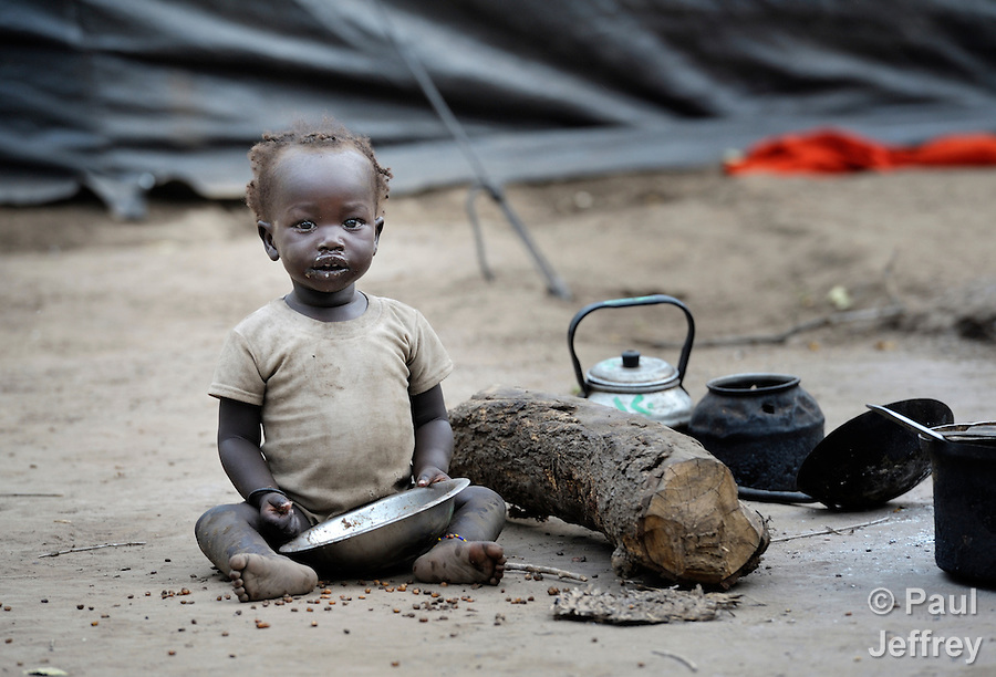 A small child sits on the ground in the Yusuf Batil refugee camp in South Sudan's Upper Nile State. More than 110,000 refugees were living in four camps in Maban County in October 2012, but officials expected more would arrive once the rainy season ended and people could cross rivers that block the routes from Sudan's Blue Nile area, where Sudanese military has been bombing civilian populations as part of its response to a local insurgency. Conditions in the camps are often grim, with outbreaks of diseases such as Hepatitis E.