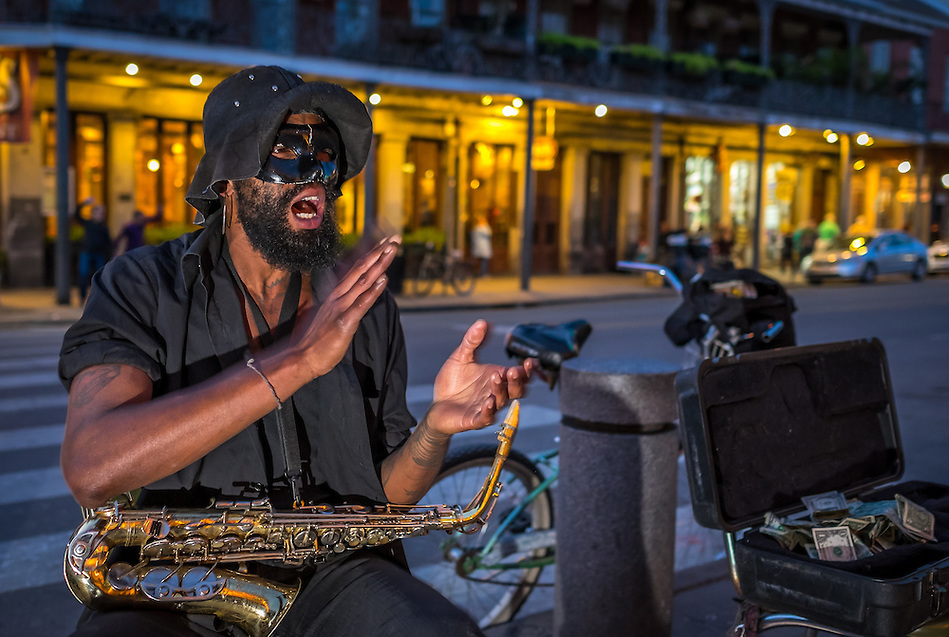 NEW ORLEANS - CIRCA FEBRUARY 2014: Street musician performing in the streets of New Orleans in Louisiana at night (Daniel Korzeniewski)