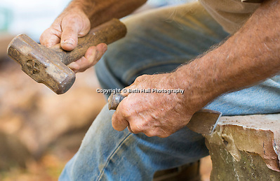 Robert Runyon uses hand tools to shape rock outside of his home in Sugar Tree Hollow in Winslow, Arkansas, for Out Here Magazine. Photo by Beth Hall (Beth Hall)