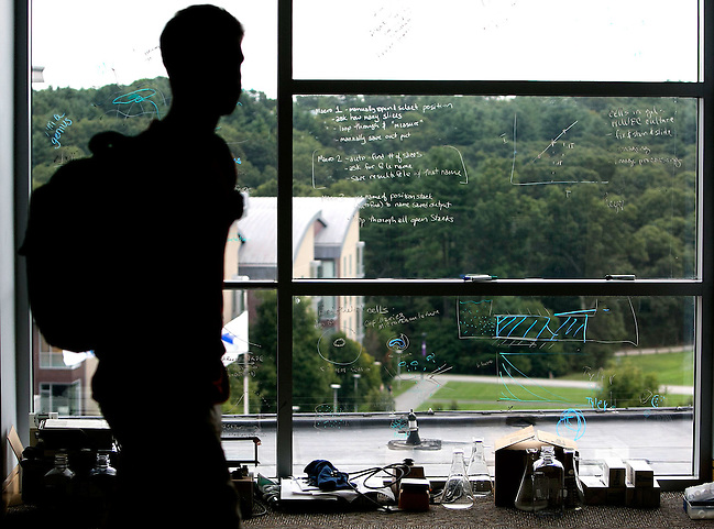 09/05/2013 -- NEEDHAM, Mass. -- A student walks past a window that was used as a whiteboard at Olin College on Sept. 5, 2013. (Kelvin Ma for the Chronicle of Higher Education) (©2012 Kelvin Ma)