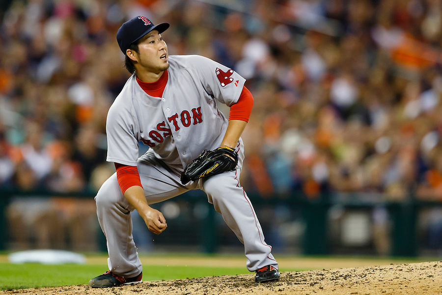 Aug 8, 2015; Detroit, MI, USA; Boston Red Sox relief pitcher Junichi Tazawa (36) watches as a ball hit by Detroit Tigers designated hitter Victor Martinez (not pictured) go over the right center field wall for a two run home run seventh inning at Comerica Park. Mandatory Credit: Rick Osentoski-USA TODAY Sports (Rick Osentoski/Rick Osentoski-USA TODAY Sports)