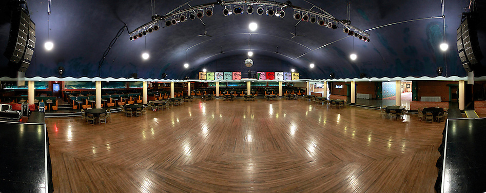 1/19/12 12:37:54 PM -- Clear Lake, IA, U.S.A. -- THIS IS FOR A LIFE COVER:.A 180 degree view of the Surf Ballroom as seen from the stage in a panoramic composite from multiple photographs..On Feb. 3, 1959, Buddy Holly, Ritchie Valens and the Big Bopper died when their plane crashed in a farm field north of Clear Lake, Iowa ? an event memorialized as ?the day the music died? in the 1971 song American Pie by Don McLean. The three 1950s stars played their last gigs at Clear Lake?s Surf Ballroom, which is intact today and holds an annual celebration of its moment in music history. The ballroom, largely the same as it was in its ?50s heyday, struggled as a for-profit business and has been operated as a non-profit since 2008. It hosts concerts, weddings, reunions and school tours. It has a small museum, but the big draw is the place itself. The maple dance floor and booths are original. One of the two original coat checks is still there and so is the phone that Holly used to call his wife before the fatal crash, the website boasts. The fun part is the annual gathering of fans from all over the world, which this year is Feb. 1-4 and is delicately called the ?winter dance party.? There are concerts each night, a bus outing to the crash site, which is marked by a giant pair of the glasses Holly wore, dance lessons, video and art contests and a gathering of the British Buddy Holly Society (whose members have been coming to Clear Lake for 23 years). Chuck Berry is a featured performer this year. It?s a charming and weird slice of Iowa life and rock ?n? roll history. -- ...Photo by Christopher Gannon for USA TODAY. (Christopher Gannon/for USA TODAY)