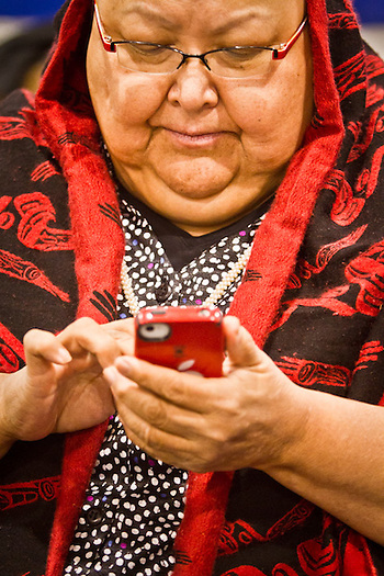 Tlingit, Della Cheney, originally from the village of Kake, checks her messages at the Alaska Federation of Natives annual convention, Dena'ina Convention Center, Anchorage, Alaska (Clark James Mishler)