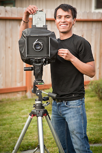 Oscar Avellaneda with his 4X5 view camera in his backyard in East Anchorage (Clark James Mishler)