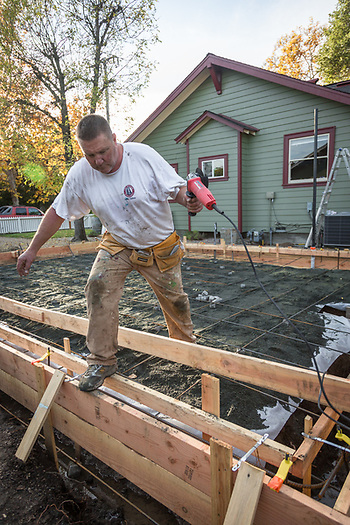 """I hire professionals to do the electrical and plumbing...I do all the grunt work.""  -Chris McAllister readies his site prior to pouring cement for the foundation of his garage project on Fair Way Street in Calistoga. (Clark James Mishler)"