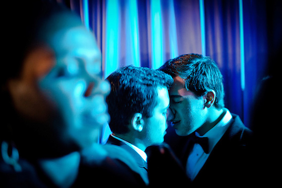 Mike Mignosi, center, and Joseph Velloni, right, of New York kiss at the Inaugural Ball, January 21, 2013 in Washington, D.C. (Max Whittaker/Prime)