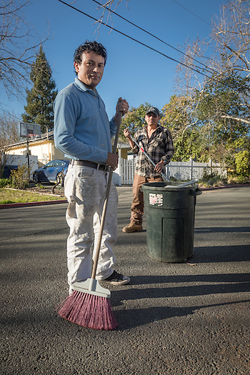 "Professional landscapper and Calistoga resident Chico Chavez with his associate, Pamfilo Ortez, finish up their work at a residence on Filmore Street in Calistoga.  ""Our day starts at 3:30 AM and usually ends at 6 PM...seven days a week."" (Clark James Mishler)"
