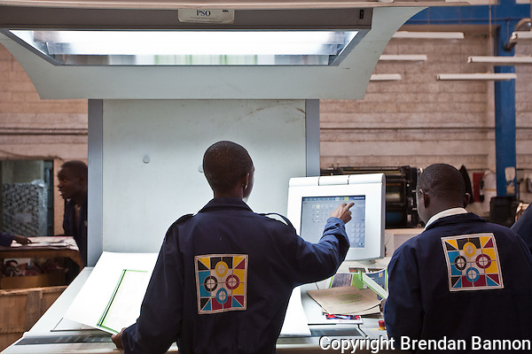 Print technicians monitoring the color balance on brochures for Safaricom, a Kenyan mobile phone company. (Brendan Bannon)